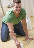 Man Cleaning Spill Stock Images