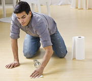 Man Cleaning Spill royalty free stock images
