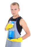 Man with cleaning spray Royalty Free Stock Images