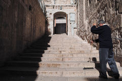 Man cleaning staircase outside the Holy Sepulcher. Jerusalem, ISRAEL. May, 2010 Royalty Free Stock Photos