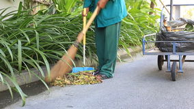 Man cleaning the street. A man cleaning the street stock video