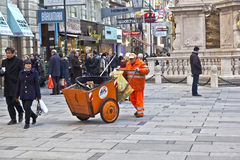 Man cleaning the street at  Graben Royalty Free Stock Image
