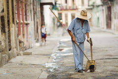 Man cleaning the street of Havana, Cuba Royalty Free Stock Photography