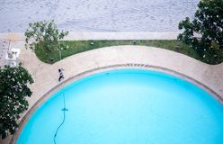 Man cleaning swimming pool with Vacuum cleaner Stock Image