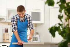 Man cleaning table with rag. In kitchen royalty free stock image