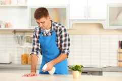 Man cleaning table with rag. In kitchen royalty free stock photos