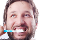 Man cleaning teeth with brush. Young man is cleaning his teeth with brush Stock Images