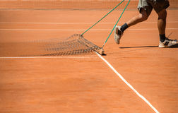 Man cleaning tennis terrain. With specific tool Royalty Free Stock Images