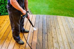 Free Man Cleaning Terrace With A Power Washer - High Water Pressure C Royalty Free Stock Photography - 124889637
