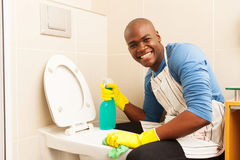 Man cleaning toilet Royalty Free Stock Photo