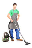 Man cleaning with vacuum cleaner Stock Photos