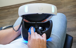 Man cleaning virtual reality glasses, close focus stock image