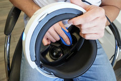 Man cleaning virtual reality glasses, close focus stock photos