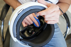 Man cleaning virtual reality glasses, shallow depth of field photo royalty free stock image