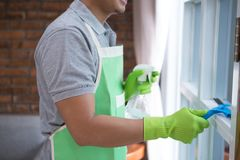 Man cleaning window. Close up man cleaning window at home Royalty Free Stock Photography