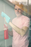 Man cleaning a window Royalty Free Stock Image