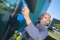 Man cleaning window in house Royalty Free Stock Photo