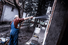 Man cleaning window Stock Images