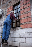 Man cleaning window Royalty Free Stock Images
