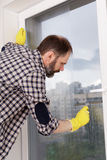Man cleaning windows Stock Images