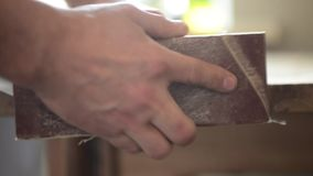 Man cleaning wood stock video