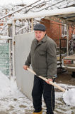 The man cleans snow. Royalty Free Stock Images