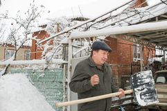 The man cleans snow. Royalty Free Stock Photography