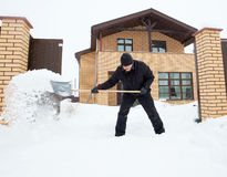 Man cleans snow shoveling Stock Photos