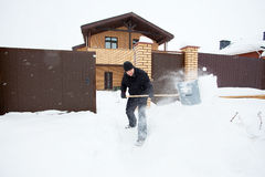 Man cleans snow shoveling Stock Photo