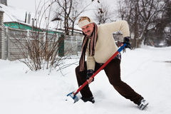Man cleans snow Stock Photo