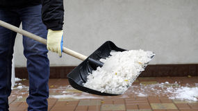 Man cleans snow from the yard Royalty Free Stock Image