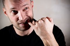Man cleans the space between the teeth with a finger