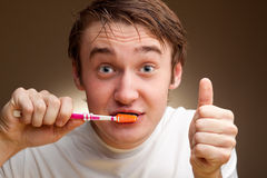 Man cleans teeth Royalty Free Stock Image