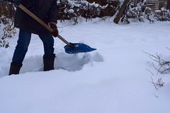 A man cleans the track from the snow royalty free stock photography
