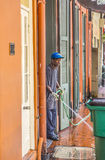 Man cleans the walkway Stock Image