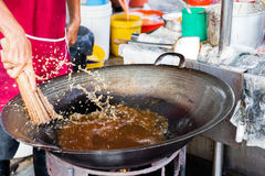 Man cleans wok at Kimberly Street Food Night Market Royalty Free Stock Photography