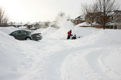 Man Clearing Driveway with Snowblower royalty free stock photography