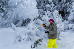Man clears snow from the mountains Royalty Free Stock Images