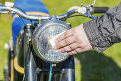 Man clen old motorcycle Stock Photography