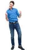 Man clenching fists. Young man over white background Royalty Free Stock Photos