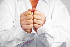 Man clenching his fists. Close up of a man clenching his fists Stock Images