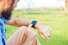 Man clicking on a screen of his smart watch Royalty Free Stock Photo