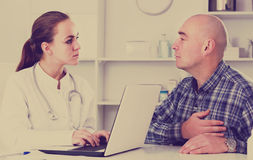 Man client visiting consultation with female doctor Royalty Free Stock Photos