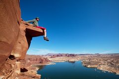 Man on the cliff. On Powell lake Stock Images