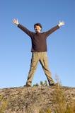 Man on cliff stock photos