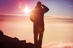 Man on the cliff. Man on the sheer cliff Stock Photo