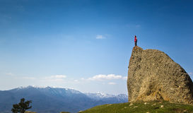 Man on the cliff in mountains at above sea Royalty Free Stock Photo