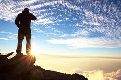 Man on the cliff. Man on the sheer cliff Royalty Free Stock Photos