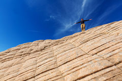 Man on the cliff. Man on the sheer cliff Royalty Free Stock Images