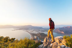 Man on the cliff. Man on the sheer cliff Royalty Free Stock Photography